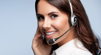 customer support phone operator in headset, with blank copyspace area for slogan or text message, over grey background. Consulting and assistance service call center.